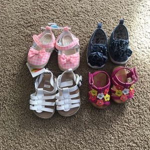 Bundle of baby girl shoes, socks, and hat